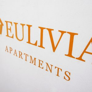 EULIVIA Apartments wall logo