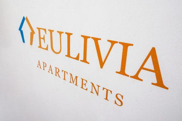 EULIVIA Apartments wall logo